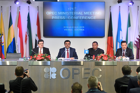 From left to right, Mohamed Hamel, chairman of OPEC, Mohammed Al-Sada, Qatar's minister of energy and industry and president of OPEC, Mohammed Barkindo, secretary general of OPEC, and Hasan Hafidh, head of public relations of OPEC, attend a news conference following the 171st Organization of Petroleum Exporting Countries (OPEC) meeting in Vienna, Austria, on Wednesday, Nov. 30, 2016. Oil rose the most in nine months after OPEC ministers were said to have forged a deal to cut production, sending stocks of energy producers and currencies of commodity-exporting nations higher. Photographer: Akos Stiller/Bloomberg via Getty Images