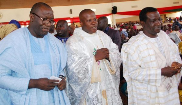 Pic 8. From Left:  Minister of Solid Minerals, Kayode Fayemi; Parish Priest of Saint Monica's Catholic Church, Rev. Fr. John Okoro and  Gov. Simon Lalong of Plateau  during the Church's Harvest and thanksgiving service in Jos on Sunday (13/11/2016).  8319/13/11/2016/ Sunday Adah /TA/NAN