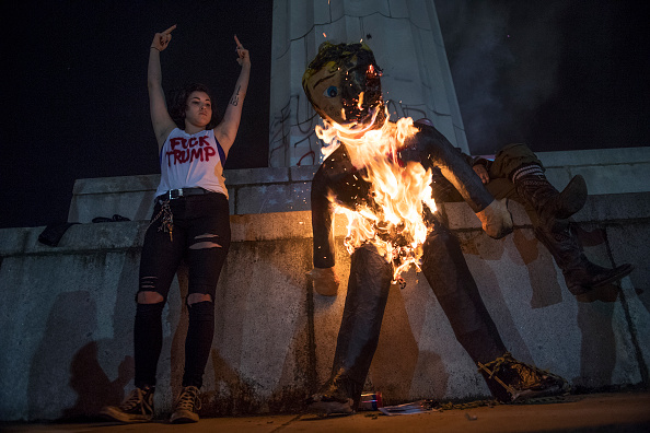 UNITED STATES - NOVEMBER 09: Protesters burn an effigy of Donald Trump in Lee Circle before a march through New Orleans, La., November 9, 2016. (Photo By Tom Williams/CQ Roll Call)