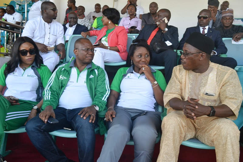 L-R: Heritage Bank Executive Directors, Adaeze Udensi, Jude Monye and Mary Akpobome with the Minister of Sports and Youth Development, Mr. Solomon Dalung, at the closing ceremony of the Heritage Bank-Lagos State Skoolimpics