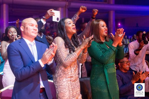 air-france-commercial-manager-arthur-dieffenthaler-founder-of-afriff-chioma-ude-and-a-guest-applauding-a-performance-at-the-show