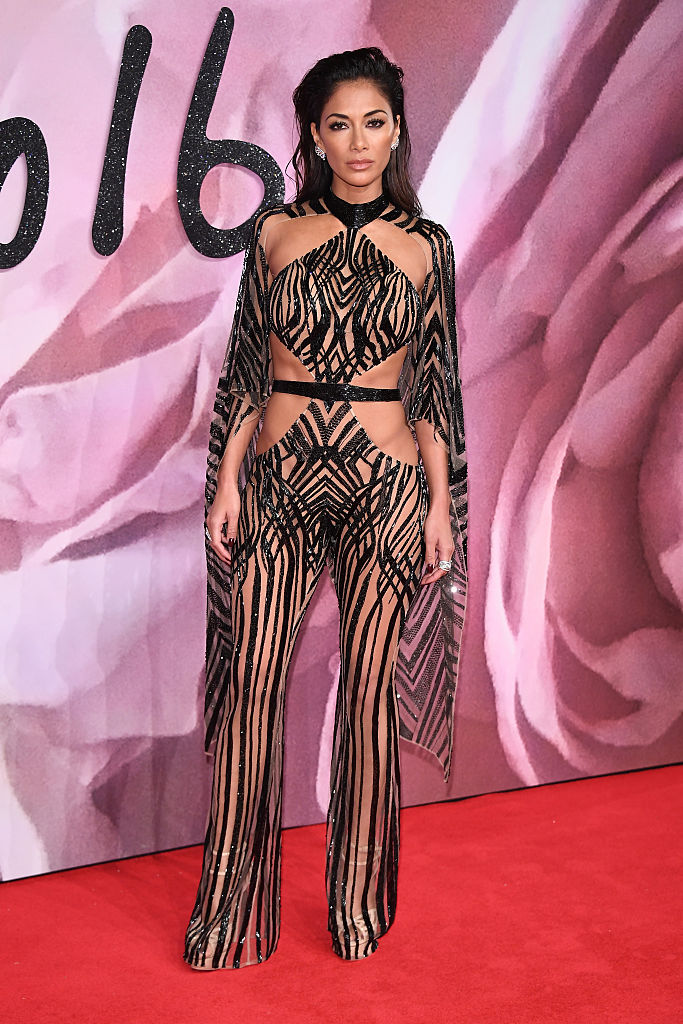 LONDON, ENGLAND - DECEMBER 05: Nicole Scherzingerwalks the red carpet for the British Fashion Awards 2016 on December 5, 2016 in London, England. (Photo by Venturelli/Getty Images for GUCCI)