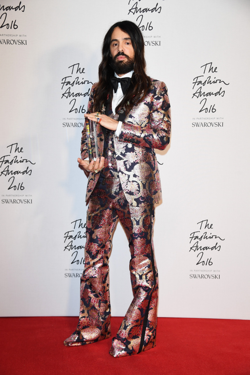 LONDON, ENGLAND - DECEMBER 05: Gucci Creative Director Alessandro Michele in the Winners Room with his award for best International Accessories Designer at the British Fashion Awards 2016 on December 5, 2016 in London, England. (Photo by Venturelli/Getty Images for GUCCI)