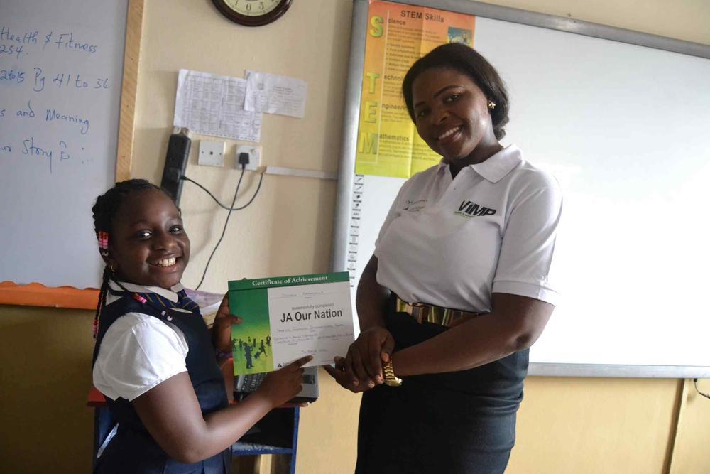 junior-achivement-nigerias-venture-in-management-programme-participant-ms-bello-muinat-presenting-a-ja-our-nation