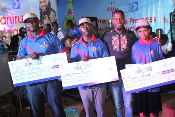 Akinola Josiah Olufemi, Assistant Brand Manager, Regional Mainstream Brands, NB Plc. With Edi Nonso, Iwechukwu Immanuel Chima Ruby and all winners of the Life Progress Booster Show in Onitsha.