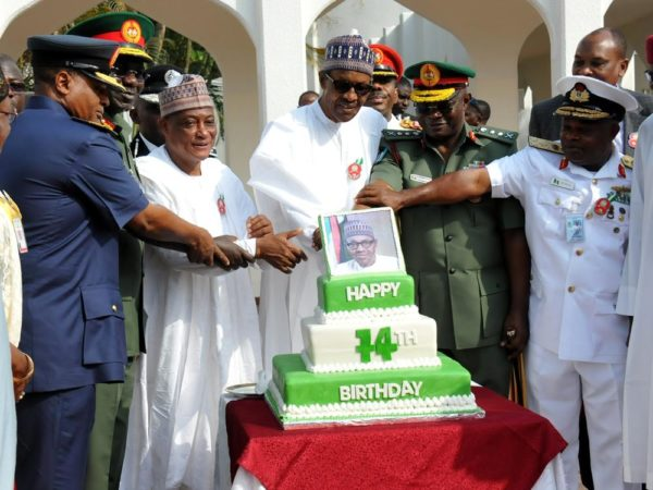From left: Chief of the Air Staff, Air Marshal sadiq Abubakar; Chief of Army Staff, Lt.-Gen Tukur Buratai; President Muhammadu Buhari; Chief of Defence Staff, Gen Abayomi Olonisakin and Chief of Naval Staff, Vice Amiral Ebuk-Ete Ibas cutting the 74th Birthday cake of the President at the Presidential Villa Abuja on Saturday (17/12/16/) 9154/17/12/2016/CALLISTUS EWELIKE/NAN
