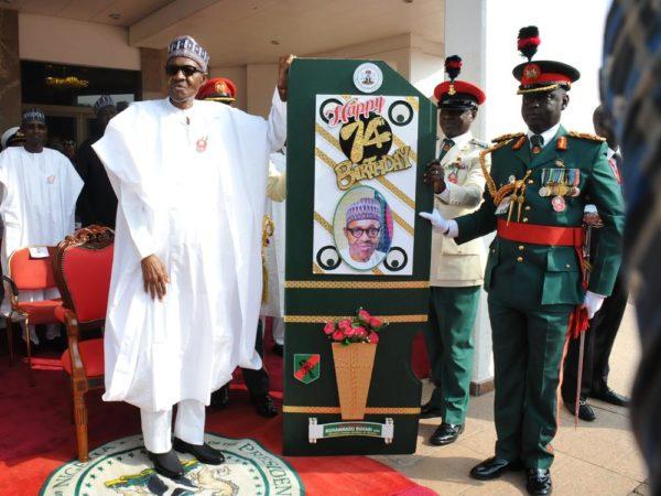 President Muhammadu Buhari (L) receiving a Birthady Card from Commander, Guards Brigade, Mohammed Yusuf during a special 74th Birthday Parade for President Muhammadu Buhari at the Presidential Villa Abuja on Saturday (17/12/16/) 9156/17/12/2016/CALLISTUS EWELIKE/NAN