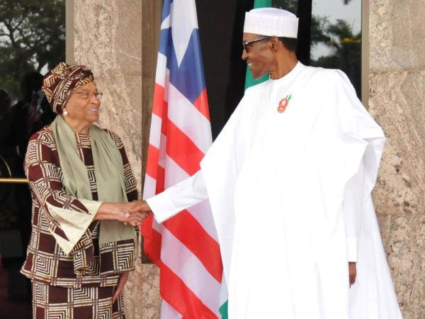 Pic.6. President Muhammdu Buhari (R) welcoming the visiting Liberian President, Mrs Ellen Johnson Sirleaf to the Presidential Villa in Abuja on Monday (5/12/16).  8856/5/12/2016/Callistus Ewelike/BJO/NAN
