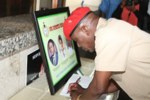 Solomon Dalung signing the Condolence Register for the deceased Corps Members at the NYSC HQ in Abuja