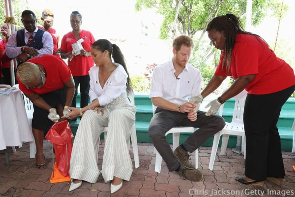 BRIDGETOWN, BARBADOS - DECEMBER 01:  Singer Rihanna (L) and Prince Harry (C) have their blood samples taken for an live HIV test, in order to promote more widespread testing for the public at the 'Man Aware' event held by the Barbados National HIV/AIDS Commission on the eleventh day of an official visit on December 1, 2016 in Bridgetown, Barbados.  Prince Harry's visit to The Caribbean marks the 35th Anniversary of Independence in Antigua and Barbuda and the 50th Anniversary of Independence in Barbados and Guyana.  (Photo by Chris Jackson - Pool/Getty Images)