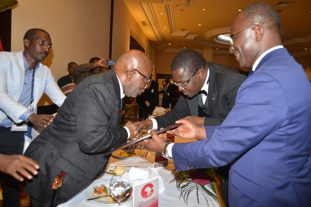 Ecobank founder gervais koffi djondo honoured with afrochampions founder of ecobank and asky airlines gervais djondo receives afrochampions lifetime awards from founder and ceo of ads group samba bathily and founder and publicscrutiny Images
