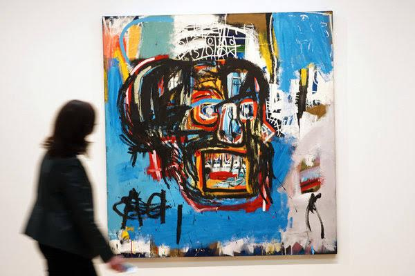 Basquiat painting fetches record $110.5 million at New York auction