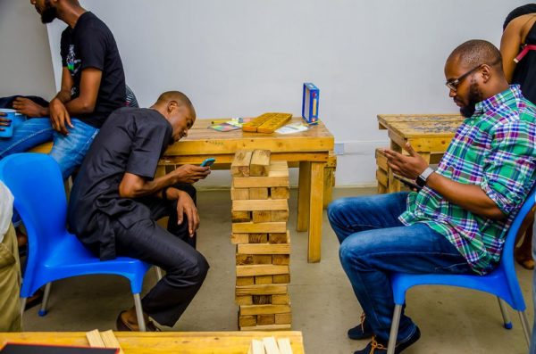 Adeolu Adefarasin and Tito Abumere playing Jenga