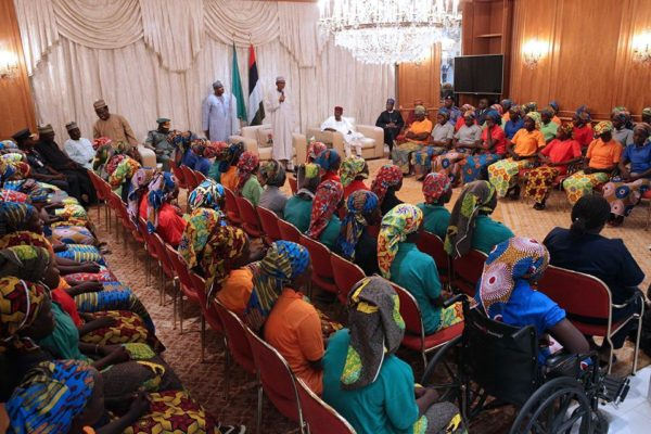 President Buhari receiving the released girls on Sunday
