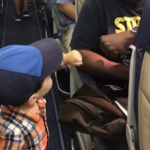 BN Living Sweet Spot Watch this Adorable 2 year old fist-bump his way through Airplane Passengers 💘Guy Jakubowicz