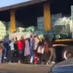 Watch #Trending video of people looting Beer Truck on the Road - BellaNaija