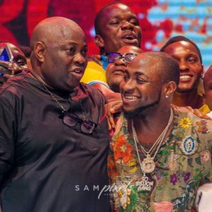 Season to Remember! Davido & Dele Momodu reconcile at Ovation Red Carol 2017