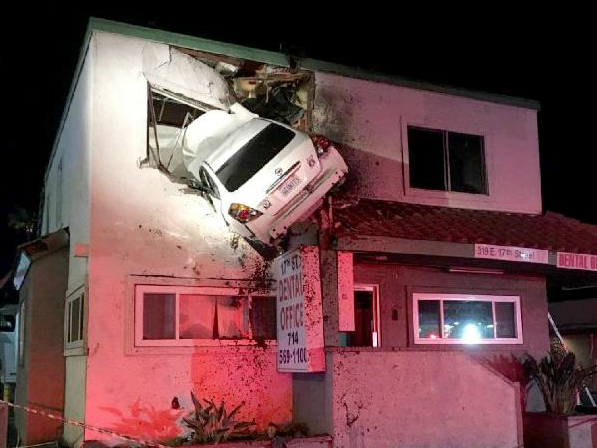 Car crashes into Upper Floor of Story-Building - BellaNaija