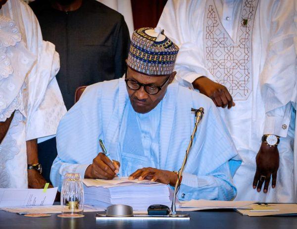President Buhari signs 2018 Budget | BellaNaija
