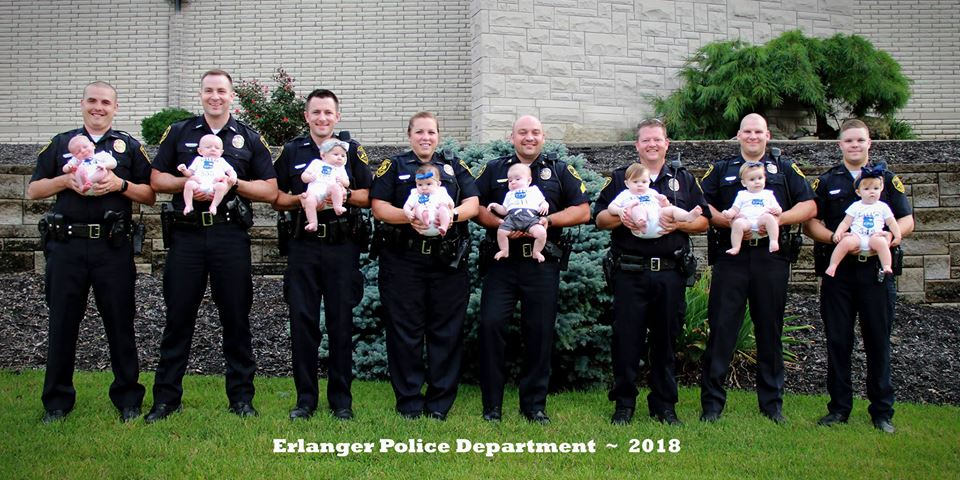 8 Police Officers from Same Department Pose with their Newborns