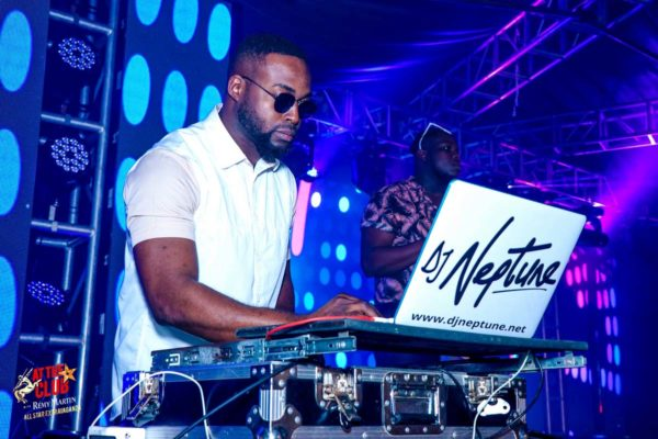 DJ Neptune playing at the club with Remy Martins