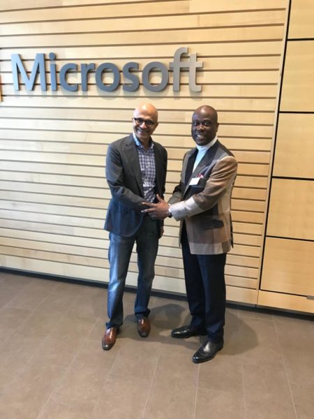 Microsoft Chief Executive Officer and Access Bank Managing Director shaking