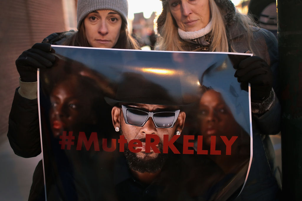 Protesters clash with R Kelly fans outside singer's notorious studio