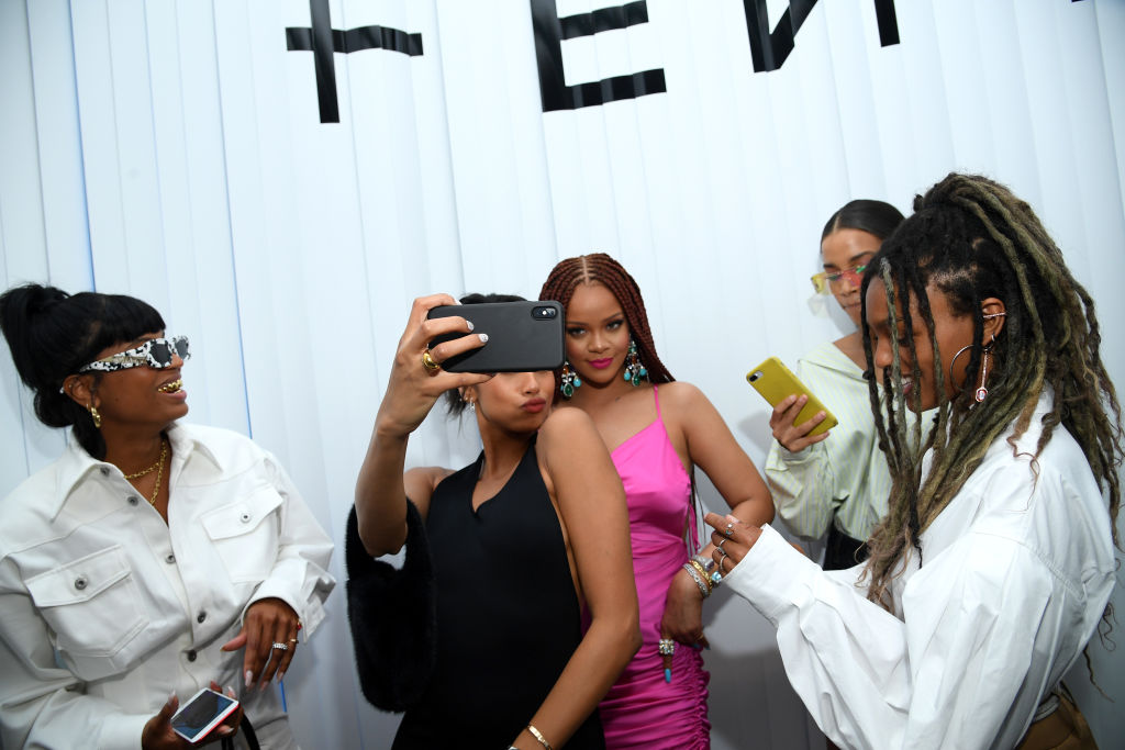 Rihanna Stuns In Curvy Pink Dress at Fashion Event -- See Her Fit!